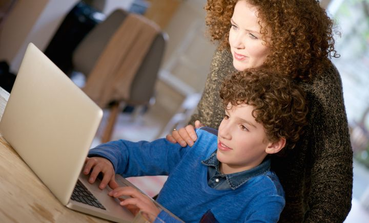 Mother and son undertaking Distance Education