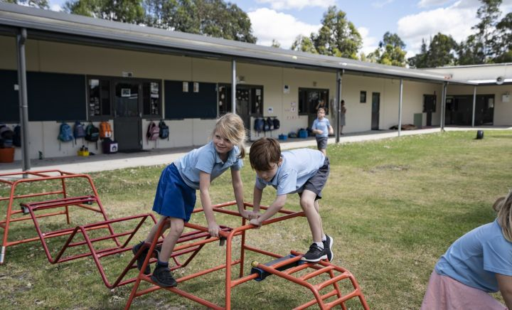 Students climb obstacles outside at Aspect Hunter School