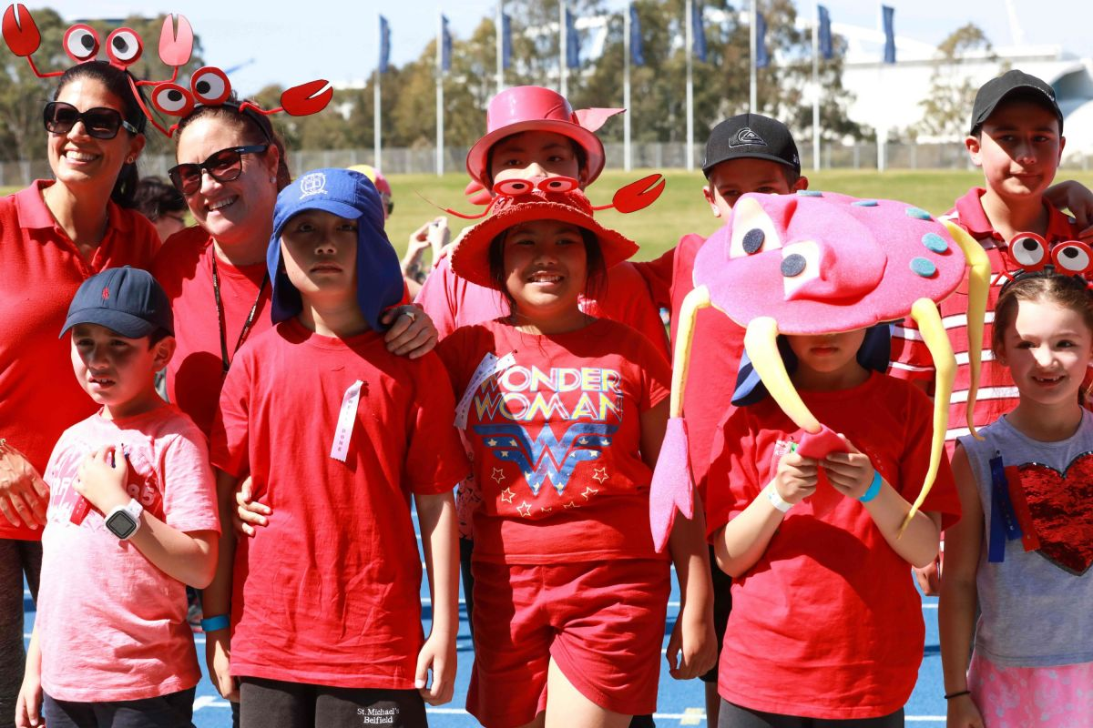 Students and adults walk around the staium showing their support for South East Sydney at Sports Carnival 2018