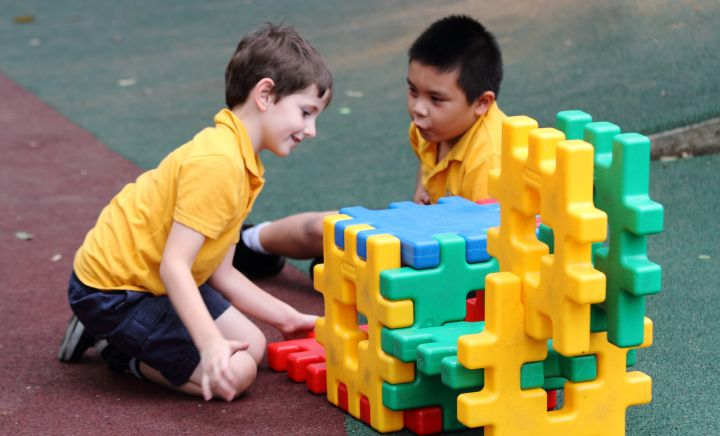 Students play with puzzle blocks in playground at Western Sydney School