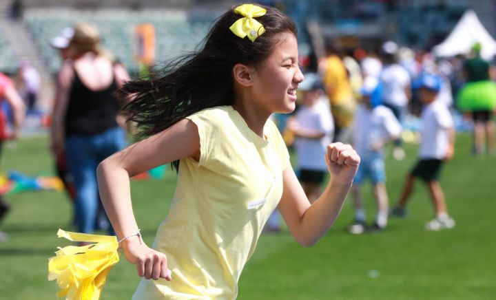 A student runs showing their determination to win for Western Sydney School
